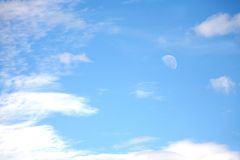 Clouds and moon. Blue sky with moon and clouds Royalty Free Stock Photography