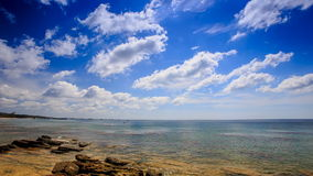 Clouds Motion above Stones in Transparent Shallow Sea Blue Sky stock footage