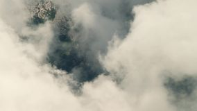Clouds in mountain stock video footage