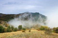 Clouds on the mountain Merdven-Kayasy. Stock Photos