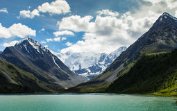 Clouds and mountain river. Big mountains , clouds and turquoise lake Royalty Free Stock Photography