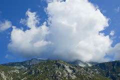 Clouds on mountain Tzoumerka, Greece Royalty Free Stock Photography