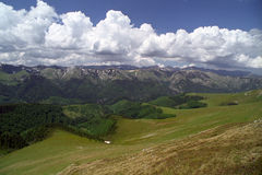 Clouds and mountains. Retezat ridges and Oslea alpine meadow Stock Images