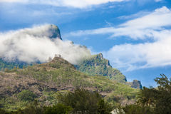 Clouds in the Mountains of Bora Bora Stock Image