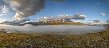 Clouds mountains fog river panorama stock image