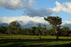 Clouds and mountains with a hint of starting rainbow and lush green vegetation in countryside Panama Stock Images
