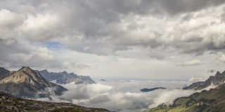 Clouds in mountains Royalty Free Stock Photos