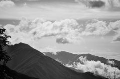 Clouds in mountains Royalty Free Stock Images