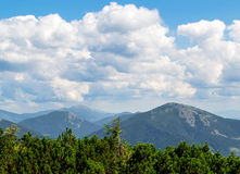 Clouds in mountains Stock Images