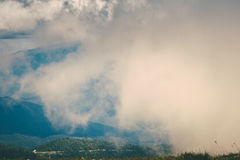 Clouds in Mountains mysterious foggy scenery Stock Photography