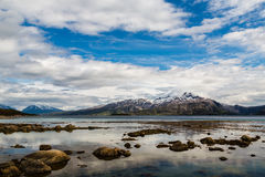 Clouds in the mountains in Norway Stock Images