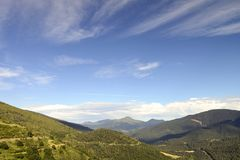 Clouds and mountains. Pyrenees spain royalty free stock images
