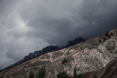 Clouds at the mountains. Stormy wheather. Black-white Stock Images