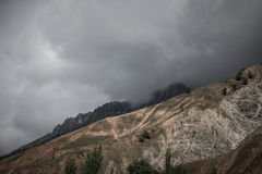 Clouds at the mountains. Stormy wheather. Toned. Dramatic Royalty Free Stock Images