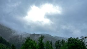 Clouds in the mountains stock video footage