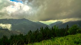 Clouds in the mountains stock footage