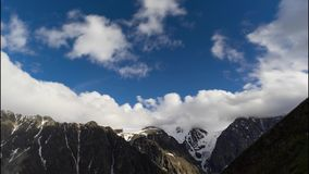 Clouds in mountains timelaps. Top of the mountain. background stock footage