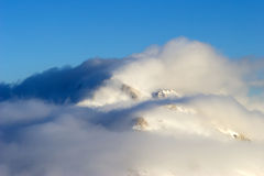 Clouds in the mountains of Turkey. Bright white Clouds and snow mountains (Turkey stock image