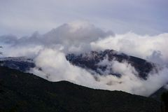 Clouds in the mountains royalty free stock images