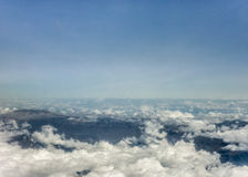 Clouds and Mountains from Window Plane Royalty Free Stock Images