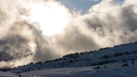 Clouds in the mountains during winter stock footage
