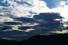 Clouds and mountans royalty free stock photography