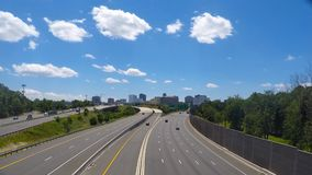 Clouds move over the beltway in northern Virginia time lapse stock video footage