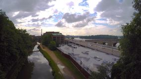 Clouds move over C&O canal and Potomac river time lapse stock video