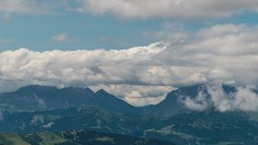 Clouds move over the European Alps. Time lapse of Cloud movement over the European Alps. 4K stock video footage