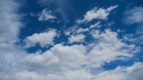 Clouds Move Smoothly in the Blue Sky. Timelapse. Sunny blue sky, white, and gray clouds. Beautiful clouds flying in the air. Time lapse. Atmospheric weather stock video