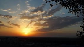 Clouds move in the sunset sky stock footage