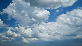 Clouds moving across blue sky Stock Image