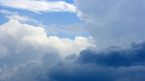 Clouds moving across blue sky stock video footage