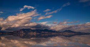 Clouds moving across Bonneville Salt Flats in Utah. Clouds moving across Bonneville Salt Flats and the hillside in the background, Utah, USA stock video footage