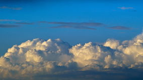 Clouds moving in blue sky stock footage