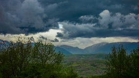 Clouds moving through the Caucasian Mountains and stock footage