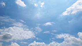 The clouds are moving fast in the sky in the daytime bright.  stock video footage