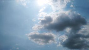The clouds are moving fast in the sky in the daytime bright.  stock video