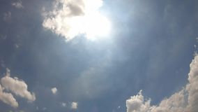 The clouds are moving fast in the sky in the daytime bright.  stock footage