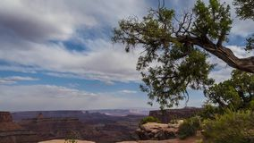 Clouds moving over the canyon at Sunset Timelapse. High Quality Time lapse made out of raw files. Canyonlands National Park Utah stock video