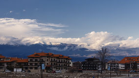 Clouds moving over the city of Bansko and mountains stock video