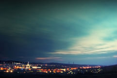 Clouds moving over a city sky. At evening with towers visible in the background Royalty Free Stock Photo