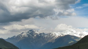 Clouds Moving over the Georgian Mountains. Mount Kazbek. Time Lapse stock footage