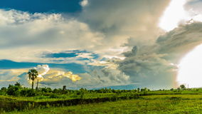 Clouds moving over the green field stock footage