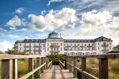Kurhaus on Juist. Clouds moving over the Kurhaus on the north sea island Juist in East Frisia, Germany, Europe stock images