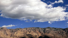 Clouds moving over mountains stock footage