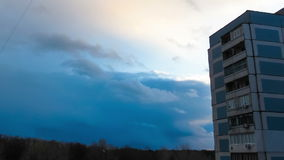 Clouds Moving over the Multistorey Buildings Time Lapse. Yard in the city with high-rise buildings over which the clouds moving in the sky. Full HD 1920 x 1080 stock video footage