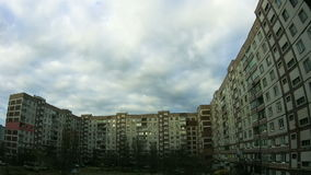 Clouds Moving over the Multistorey Buildings Time Lapse stock video