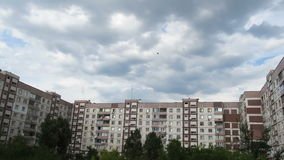 Clouds Moving Over The Multistorey Buildings. Time Lapse. Clouds Moving Over The Multistorey Buildings. Yard in the city with high-rise buildings over which the stock video