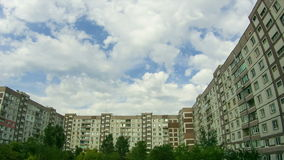 Clouds Moving Over The Multistorey Buildings. Time Lapse stock video footage